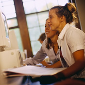 Two students working together on a computer assignment