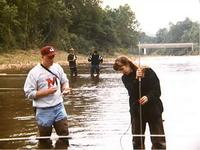 Photo of students measuring streamflow