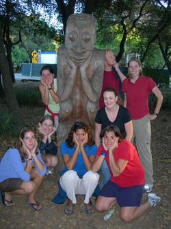 participants and statue, Stanford campus