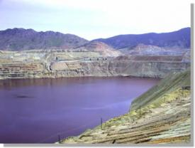 The notorious Berkeley Pit a defunct open pit copper mine in Butte Montana