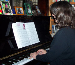 Kim playing piano