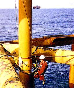 Inspector on offshore oil drilling rig