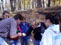 Cam Davidson and some of the Intro Geo class examine a chunk of Platteville Limestone