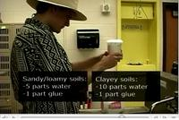 Student makes water/glue mixture for soil monolith