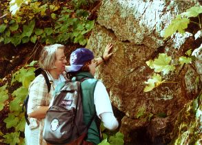 Mary Savina and a student investigate an outcrop