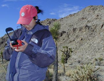 A student uses a GPS connected to a PDA to determine their location