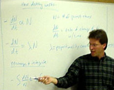 Dr. Cam Davidson explaining radioactive decay.